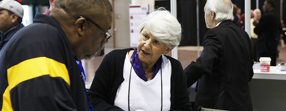 Staff member helps attende at the 2014 Annual Conference